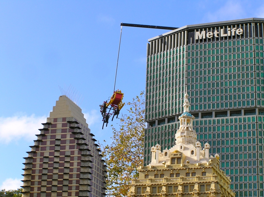 A lost Santa flying circles around New York's MetLife building.