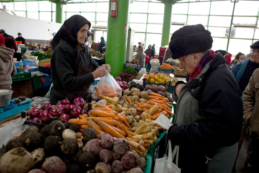 A man purchases vegetables at a market in Bucharest, Romania. (Photographer: Davin Ellicson/Bloomberg)