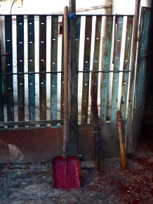 Tools of the trade. The shovel to scoop the coagulating blood off the floor. The brooms to sweep the flowing blood and water into the dirt throughout the entire process.