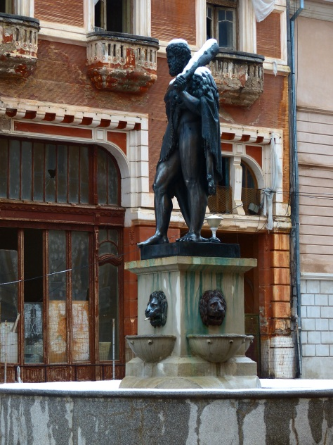 Created over one hundred years ago, this sculpture of the town's namesake has weathered time well. The buildings over which he stands watch have not.