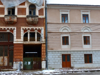 One facade is in great need of attention. Beside it, the facade has already been renovated.