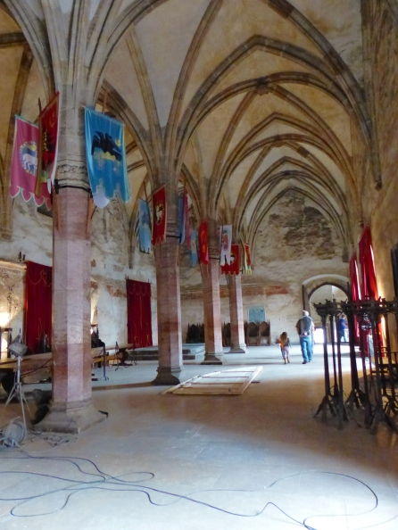 A grand hall on the second floor. Having not visited before, I don't know if the banners, candelabras and wall-hangings were for filming purposes or is a normal part of the decor.