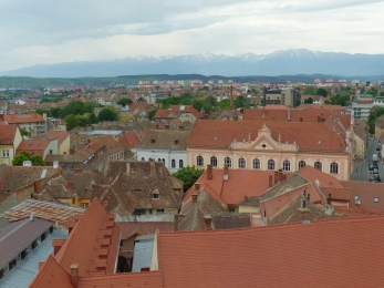 The Fagaras mountains are breathtaking in the distance, visible from a high lookout point such as the council tower.