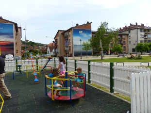 The playground in Donji Milanovac, sandwiched between the Danube and apartment buildings with massive stunning billboards.