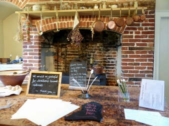The kitchen hearth, where you can try your hand at quill and ink.